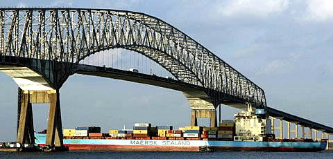 A container ship passes under the Francis Scott Key bridge as it steams up the Chesapeake Bay toward the Port of Baltimore.